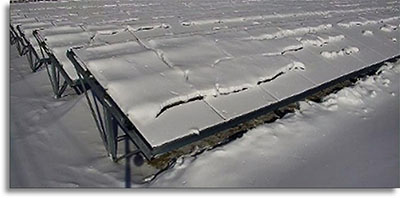 Bifacial solar panels covered in snow